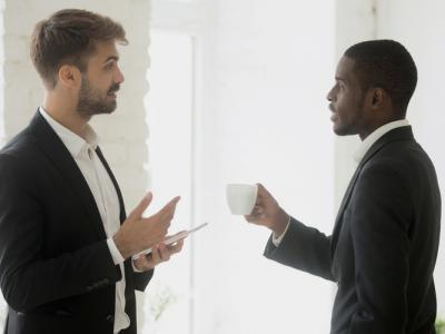 Two multi-ethnic businessmen talking