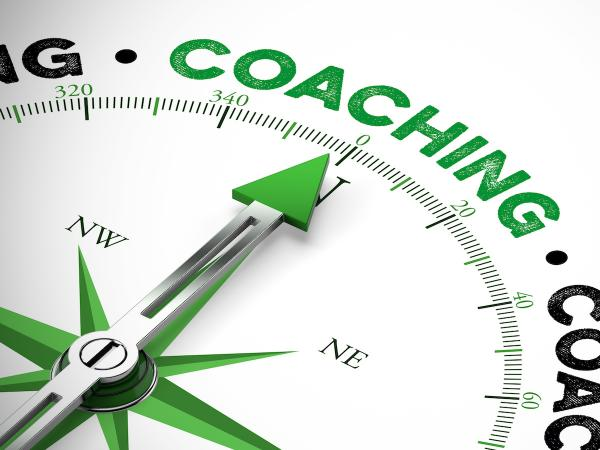 Compass with the needle pointing to the word Coaching